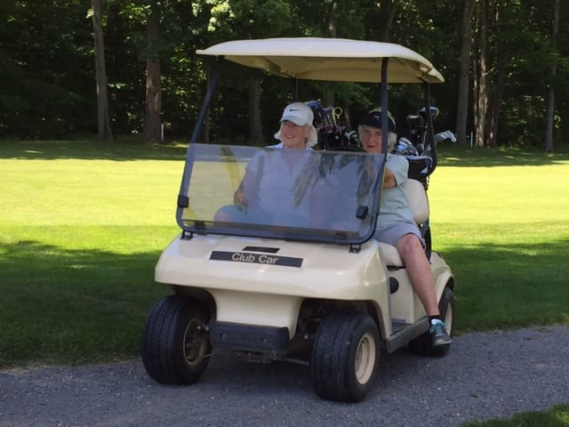 Maggie and Marie in cart