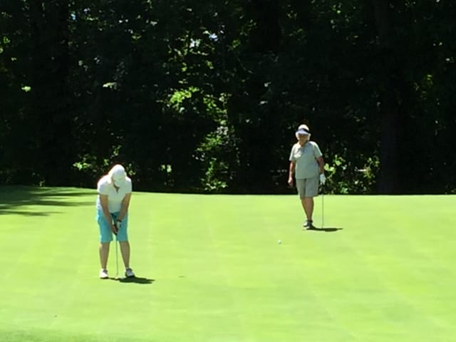Marie and Maggie putting on 2